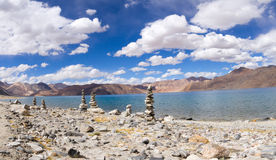 Pangong Tso mountain lake panorama with Buddhist stupas in foref Royalty Free Stock Images