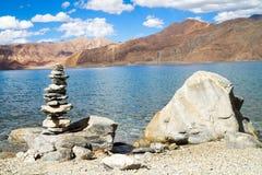 Pangong Tso mountain lake panorama with Buddhist stupas in foref Stock Photography