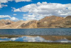 Pangong Tso mountain lake panorama with mountains and blue sky r Stock Images
