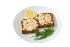 Pani tostati con i merluzzi ed il limone Fotografia Stock
