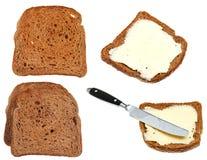 Pani tostati del burro e del pane isolati su bianco Fotografia Stock