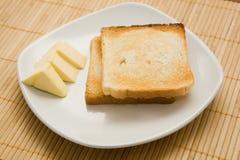 Pani tostati e burro Immagini Stock Libere da Diritti