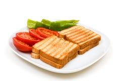 Pani tostati squisiti con i pomodori ed i peperoni Fotografia Stock Libera da Diritti