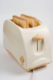 Pani tostati in tostapane Fotografie Stock