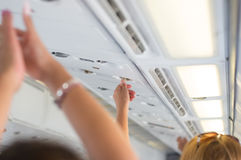Panic in an airplane. People have protection explanation in case of emergency in an airplane royalty free stock photo
