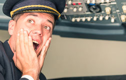 Panic in the airplane with pilot screaming for sudden failure Royalty Free Stock Photo