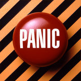 Panic button. Button to press when problems or trouble arises. Red with white panic letters Royalty Free Stock Photo