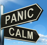 Panic Or Calm Signpost Showing Chaos Relaxation And Rest Stock Image