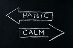 Panic or calm. Stop panicking stay easy and relaxed keep calming down handwritten on blackboard stock photos