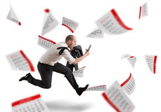 Panic deadlines. Man runs screaming with calendar sheets background Royalty Free Stock Photo