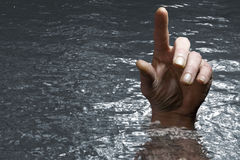 Panic despair drowning. Concept image of hand in the water finger pointing stock image