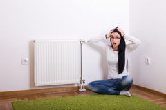 Panic emotion because of cold radiator Royalty Free Stock Images