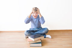 Panic before exams. Male student panicking about his future exams Stock Image