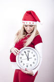 Panic pregnant woman with christmas hat and clock Royalty Free Stock Photos