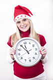Panic pregnant woman with christmas hat and clock Stock Images