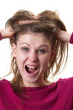 Panic time. Young panic woman in purple sweater isolated over white background Stock Images