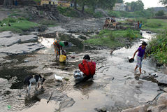 Panic For Water. Once a river have  become  canal due to continuous changing  the geomorphic features. Due to occupy the land Jharia people turn to refugee Stock Image