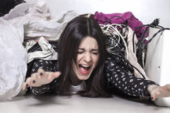 Panicked girl buried under mess Royalty Free Stock Images