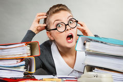 Panicked secretary at desk. Emotions shock corporation clerk administration concept. Panicked secretary at desk. Young nervous lady doing job in office Royalty Free Stock Photography