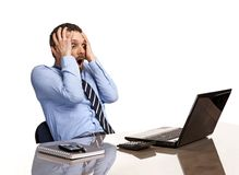 Panicking businessman in horror looking at the laptop screen - isolated on white background