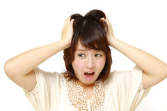 Panicking young woman Royalty Free Stock Photos