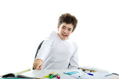 Panicky Caucasian smooth-skinned boy pointing to homework Royalty Free Stock Photos