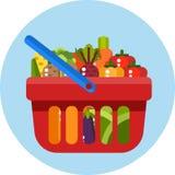Panier à provisions rouge avec des légumes Withvegetables de panier à provisions Photos stock
