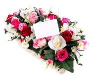 Panier décoré de fleurs Photos libres de droits