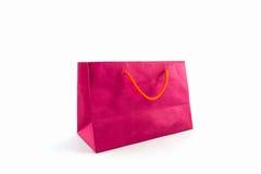 Panier de papel rosado en blanco fotos de archivo libres de regalías