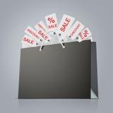 Panier de papier fort arrière avec le sort d'étiquettes sur le fond gris Photos libres de droits