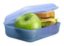 Panier-repas avec une pomme d'isolement sur le blanc photo libre de droits