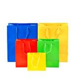 Panieres coloridos clasificados Concepto de la venta - mano con la lupa imágenes de archivo libres de regalías