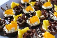 Paniers crèmes oranges de chocolat Image libre de droits