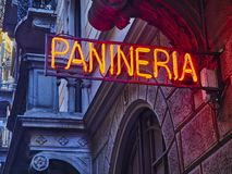 Panineria Neon signboard in an European street royalty free stock image