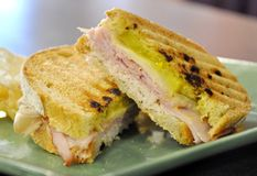 Panini. Grilled turkey panini with pickles and cheese Stock Photography