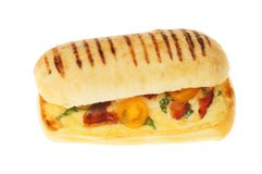 Panini against white. Cheese, tomato, basil and pancetta panini isolated against white, top view stock photos