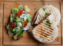 Panini com salada lateral Imagem de Stock Royalty Free
