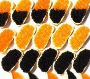 Panini con il caviale rosso e nero Immagine Stock Libera da Diritti