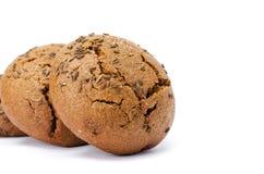 Panini con la bugia una dei semi di cumino ad un altro Immagine Stock Libera da Diritti