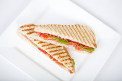 Panini. Fresh toasted panini blt sandwich with grill marks Stock Photos