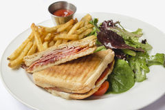 Panini with Ham Melted Cheese French Fries and Salad Royalty Free Stock Photos