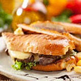 Panini. Italian Sandwich with French Fries and Vegetables Stock Image