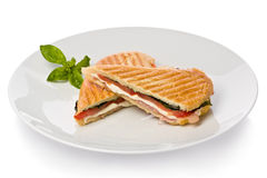 Panini Sandwich. With prosciutto, mozzarella cheese and basil on white plate Stock Photography