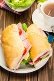 Panini sandwich with ham, cheese and tomato. Italian panini sandwich with ham, cheese and tomato Royalty Free Stock Photo