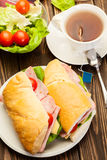 Panini sandwich with ham, cheese and tomato. Italian panini sandwich with ham, cheese and tomato Royalty Free Stock Image