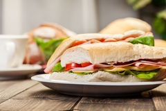 Panini sandwich with ham, cheese and tomato. Italian panini sandwich with ham, cheese and tomato Stock Photography