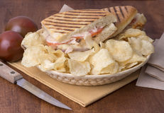 Panini sandwich. Toasted panini sandwich with chips Royalty Free Stock Photo
