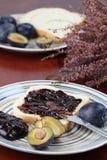 Panino alla marmellata della prugna Immagini Stock