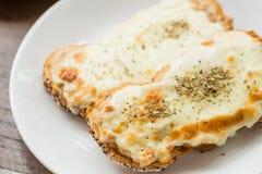 Panino arrostito del formaggio e del prosciutto Fotografie Stock