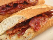 Panino delle baguette del bacon fotografia stock libera da diritti